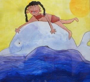 Mädchen auf einem Delfin