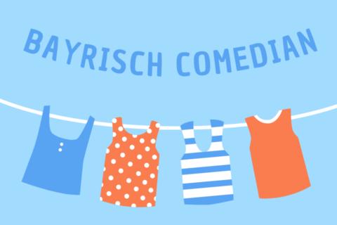 Weisse Wäschleine mit bunten aufgehängten bunten Shirts mitdem Tittel Bayrisch Comedian