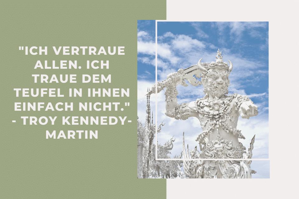 Statue Teufel (Jak)  und Zitat: Ich vertraue allen. Ich traue dem Teufel in ihnen einfach nicht. - Troy Kennedy-Martin